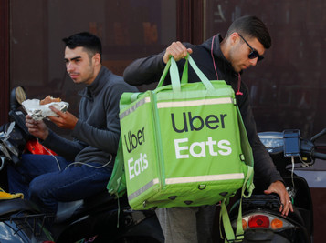 Uber Buys Meal Delivery Service Postmates for $2.65 Billion