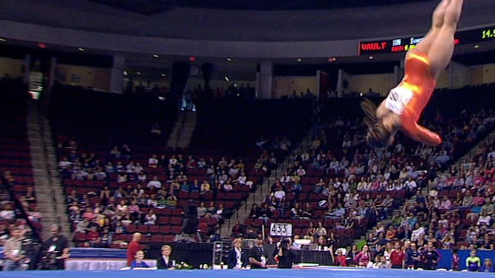 A gymnast completing a layout in a floor routine